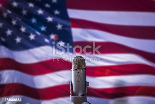 A Microphone In Front Of A USA Flag Ready For A Public Address From The President Or Other Government Figure