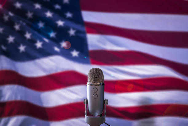 US Flag And Microphone A Microphone In Front Of A USA Flag Ready For A Public Address From The President Or Other Government Figure president stock pictures, royalty-free photos & images