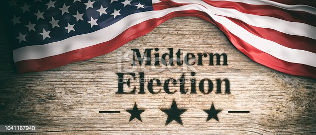 1157022917 istock photo USA flag and midterm elections, wooden background, 3d illustration 1041167940