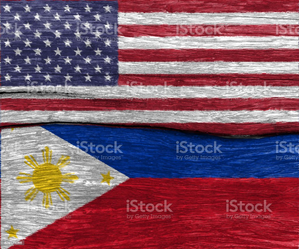USA Flag And Philippines On Wood Texture Background Floor Royalty Free Stock Photo