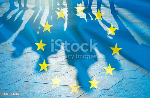istock EU Flag and shadows of People concept picture 909106096