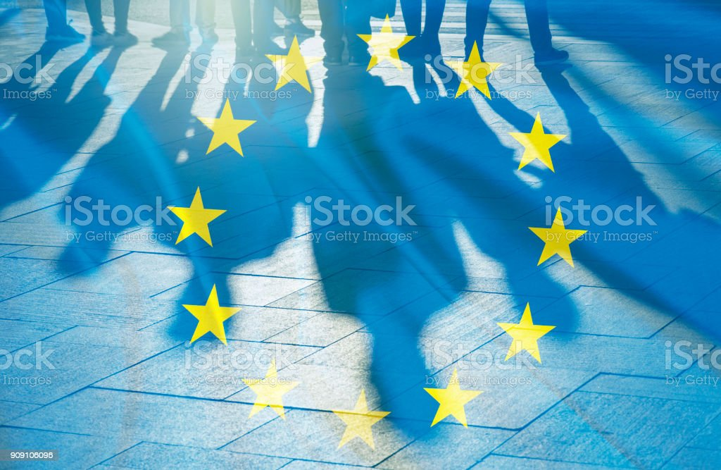 EU Flag and shadows of People concept picture stock photo