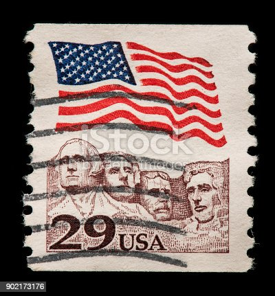 US flag and the 4 Presidents Carved On Mount Rushmore Stamp.