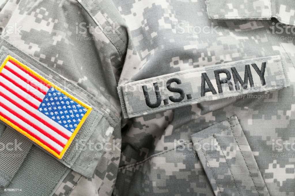 Us Flag And Us Army Patch On Military Uniform Studio Shot
