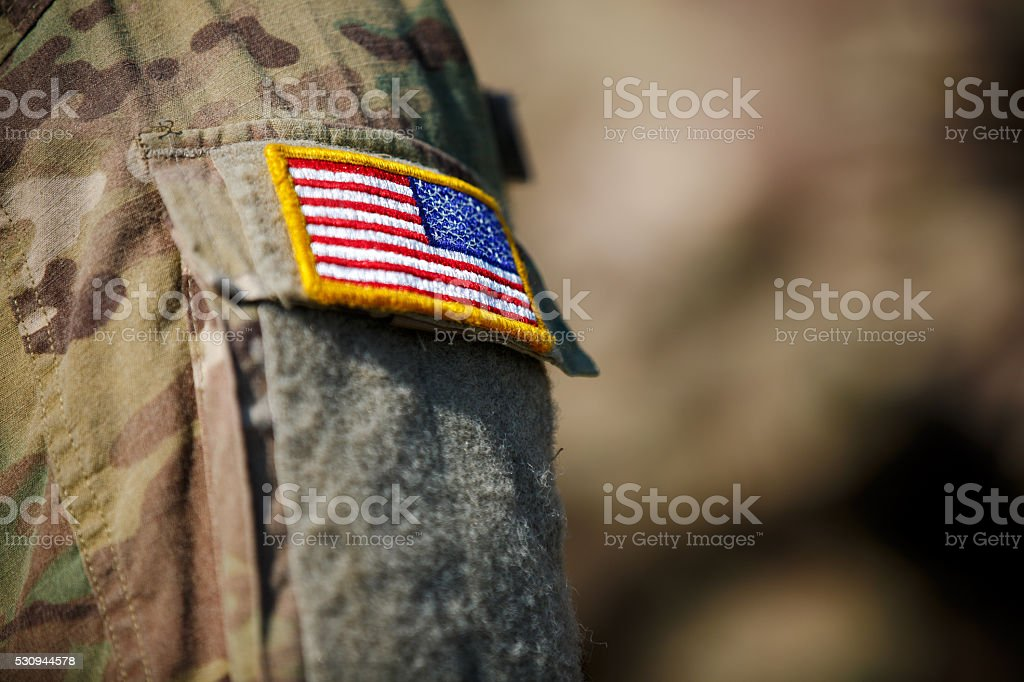 USA flag and US Army patch on solder's uniform stock photo