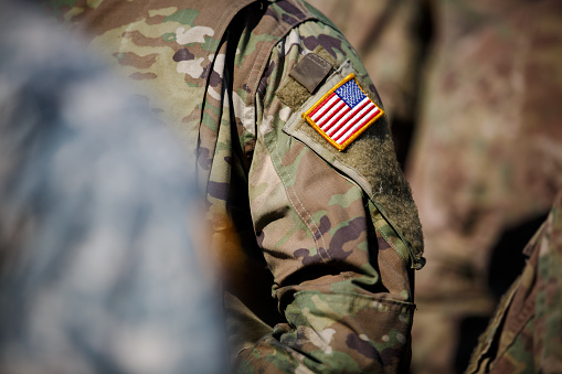 istock USA flag and US Army patch on solder's uniform 530944770