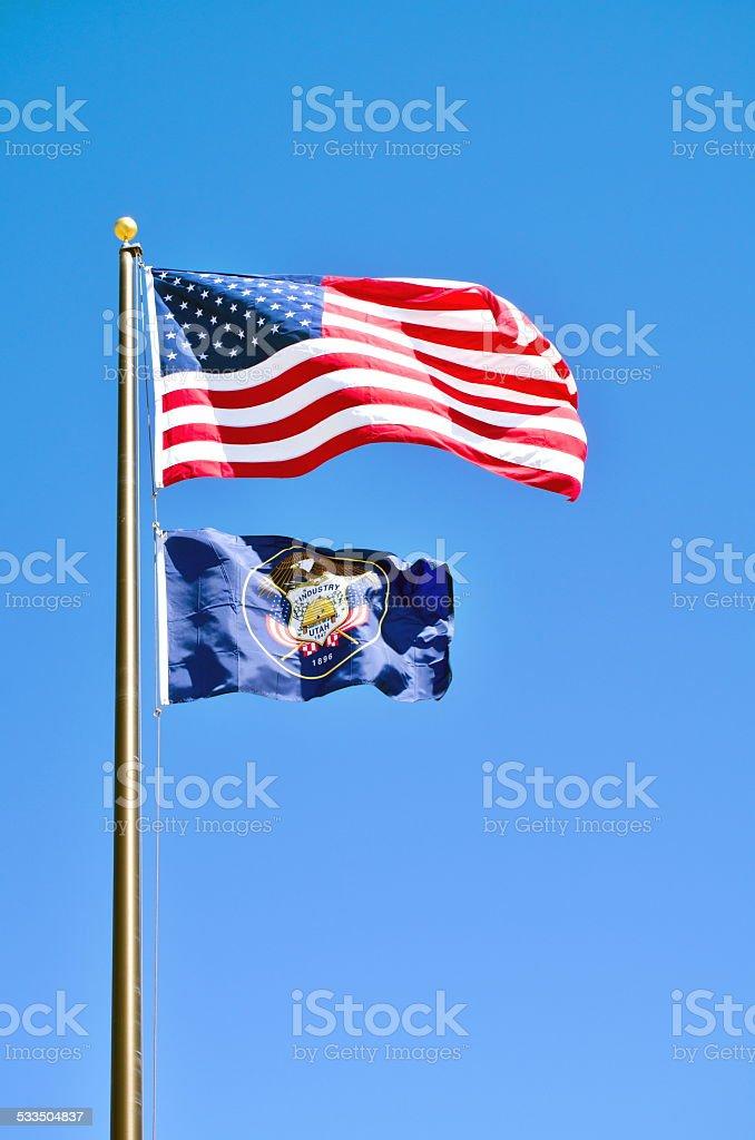 USA flag and Utah State flag wavings on Kodachrome S.P. stock photo
