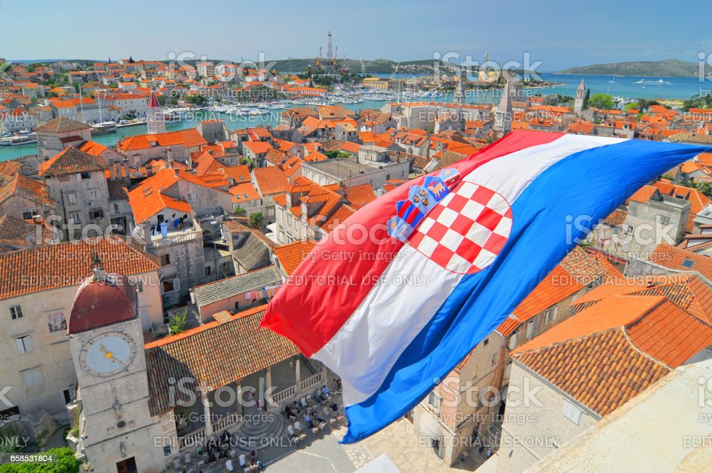 Flag and view on Trogir, Croatia. stock photo