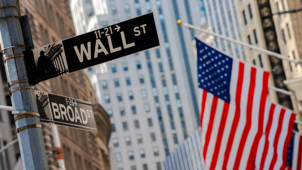 Flag and Wall street sign Flag hanging on a facade manhattan financial district stock pictures, royalty-free photos & images
