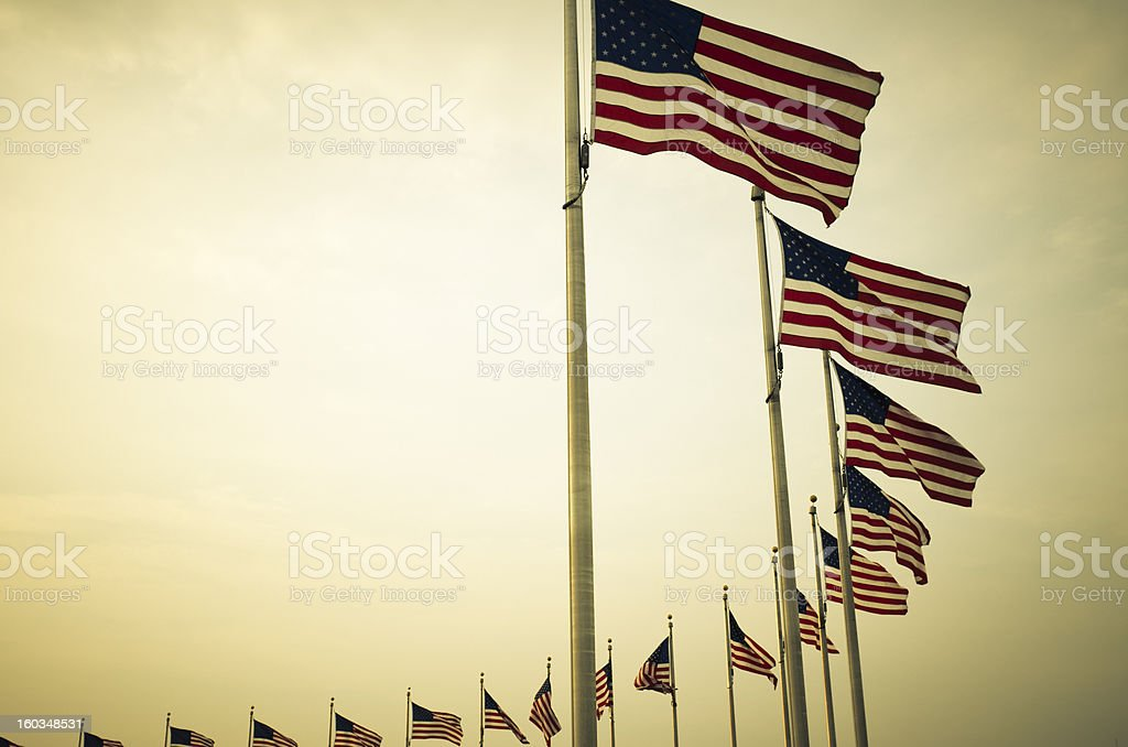 US flag around the Washington Monument royalty-free stock photo