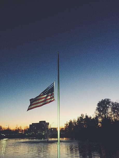 USA Flag at Half Mast stock photo