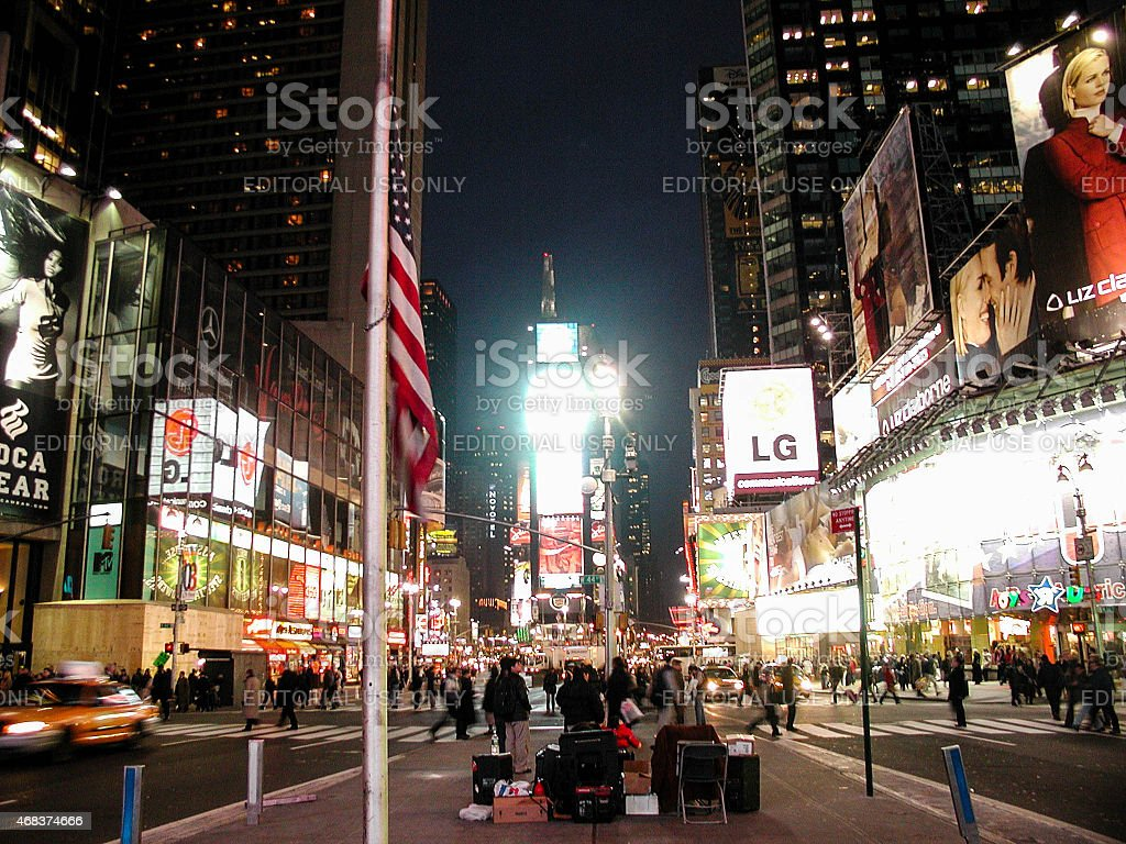 U.S. Flag at Half-Mast in Times Square stock photo