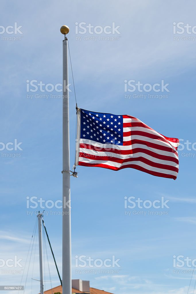 US Flag at half-mast stock photo
