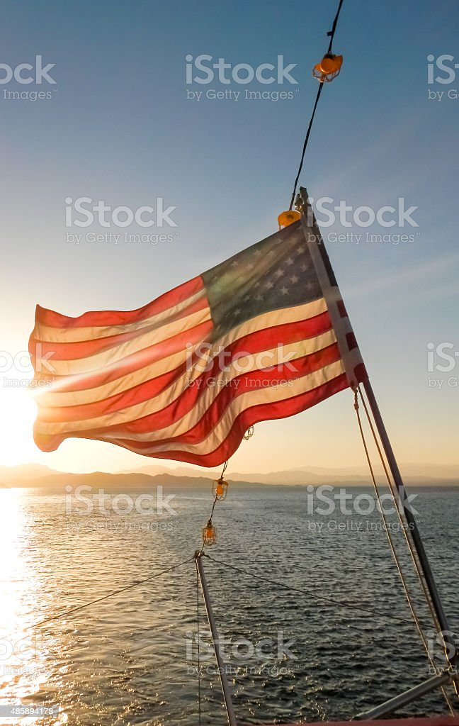 US Flag at Sunset stock photo