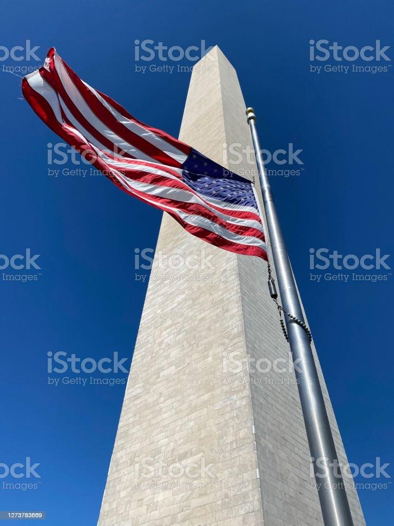 Flag at Washington Monument/Ginsburg Flag at half staff in honor of Ruth Bader Ginsburg American Flag Stock Photo