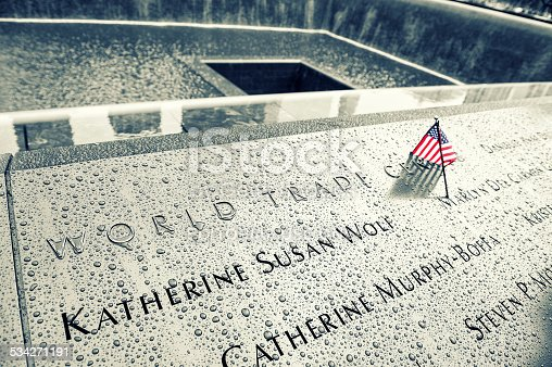 New York, United States - September 12, 2013: NYC's 9/11 Memorial at World Trade Center Ground Zero seen on September 12, 2013. The memorial was dedicated on the 10th anniversary of the Sept. 11, 2001 attacks.