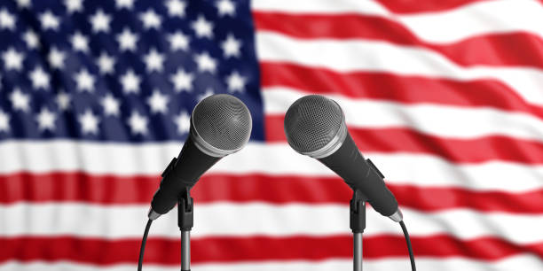 USA flag background with two microphones in front of it. Close up view. 3d illustration America blur flag backdrop, two cable microphones in front. Political, business concept. 3d illustration debate stock pictures, royalty-free photos & images