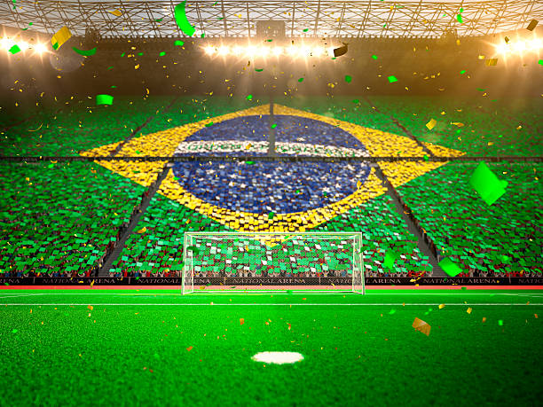 Flag Brazil of fans. Evening stadium arena stock photo