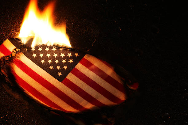 Flag Burning Burning American flag, perhaps in protest burning stock pictures, royalty-free photos & images