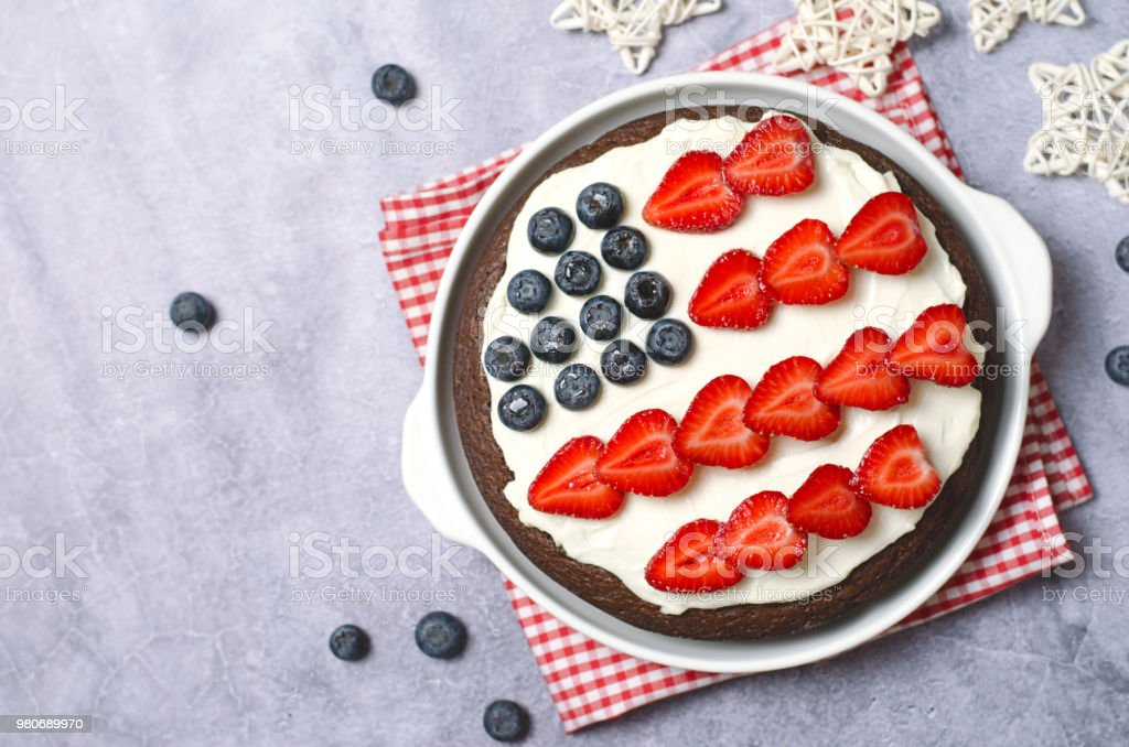 USA Flag Cake, Patriotic 4th of July Dessert, Brownie Decorated with Berries and Cream Cheese, Creative Food stock photo