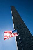istock USA flag dark sky and Washington Monument 485011410