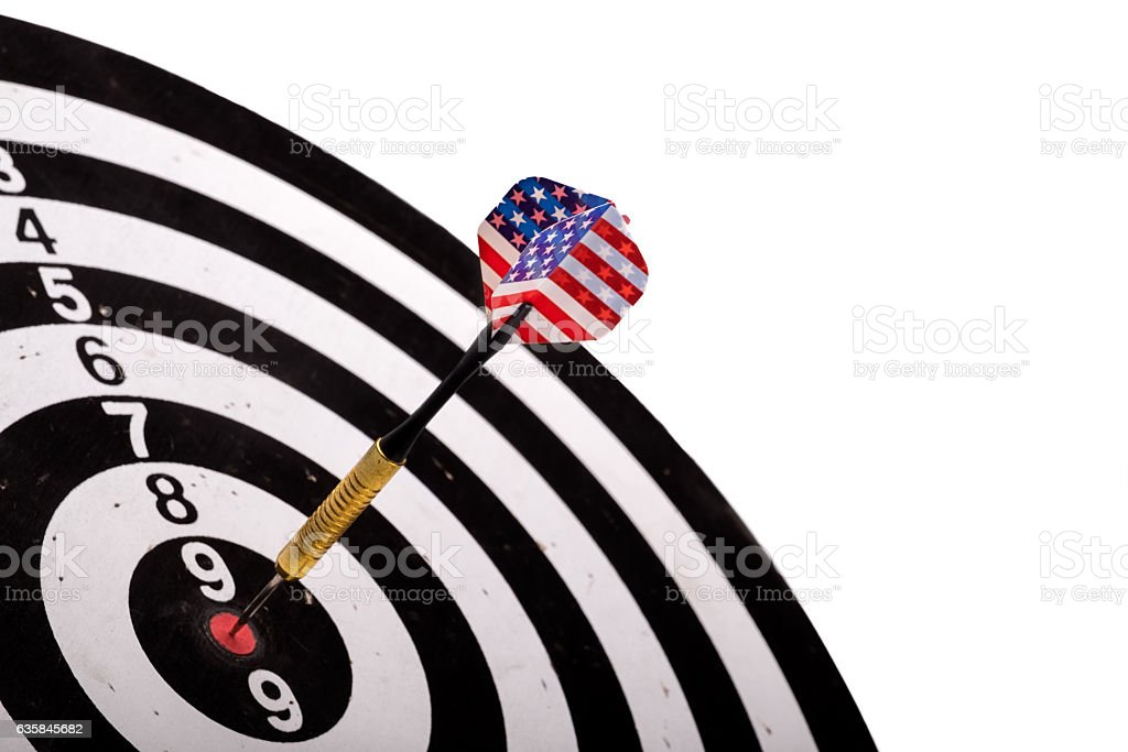 USA Flag Dart Stuck in a Bullseye Board with copy stock photo