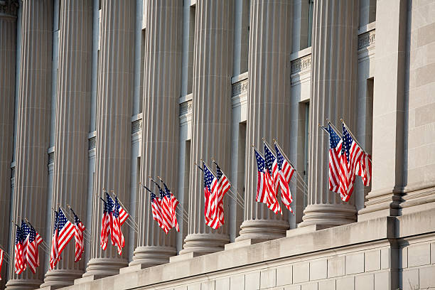 us flag decorations between columns for obama's swearing in - inauguration stok fotoğraflar ve resimler