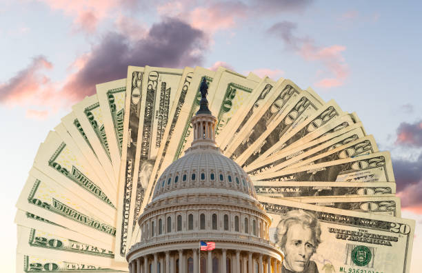 Flag flies in front of Capitol in DC with cash behind the dome as concept for stimulus virus payment stock photo