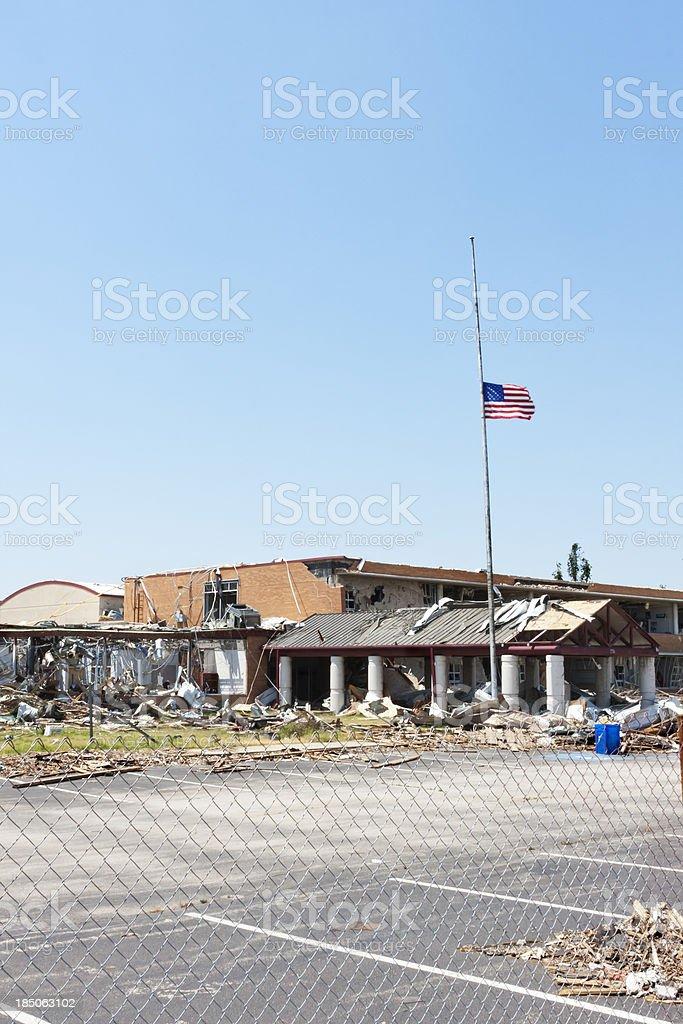 Flag Flies Outside a Tornado Damaged School royalty-free stock photo