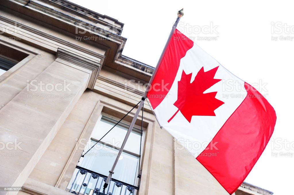 Flag flowing in the wind of the Canada House in England stock photo