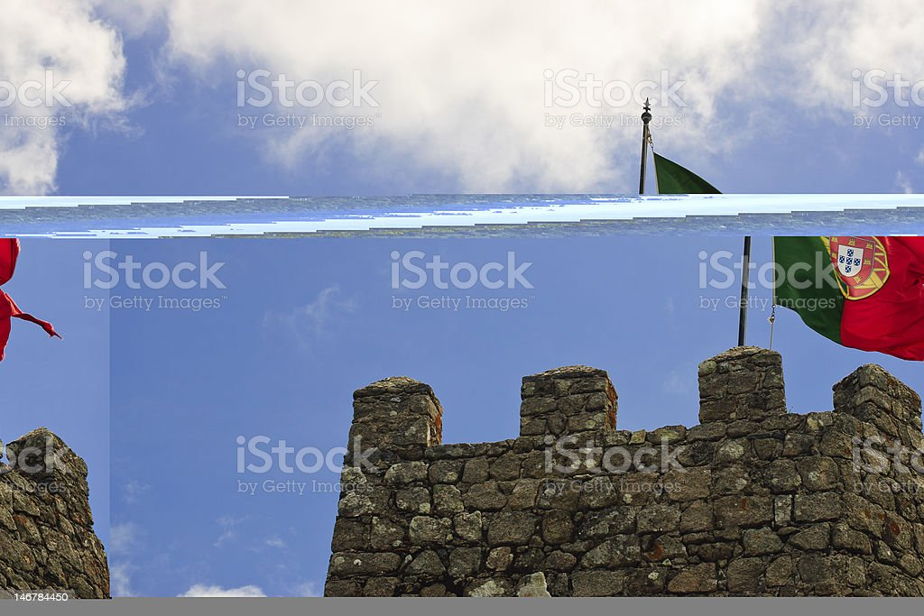 Flag Flying Above Castle Tower stock photo