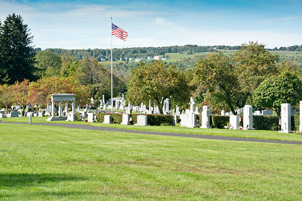 Flag flying at the Hope Cemetery in Barre, Vermont stock photo