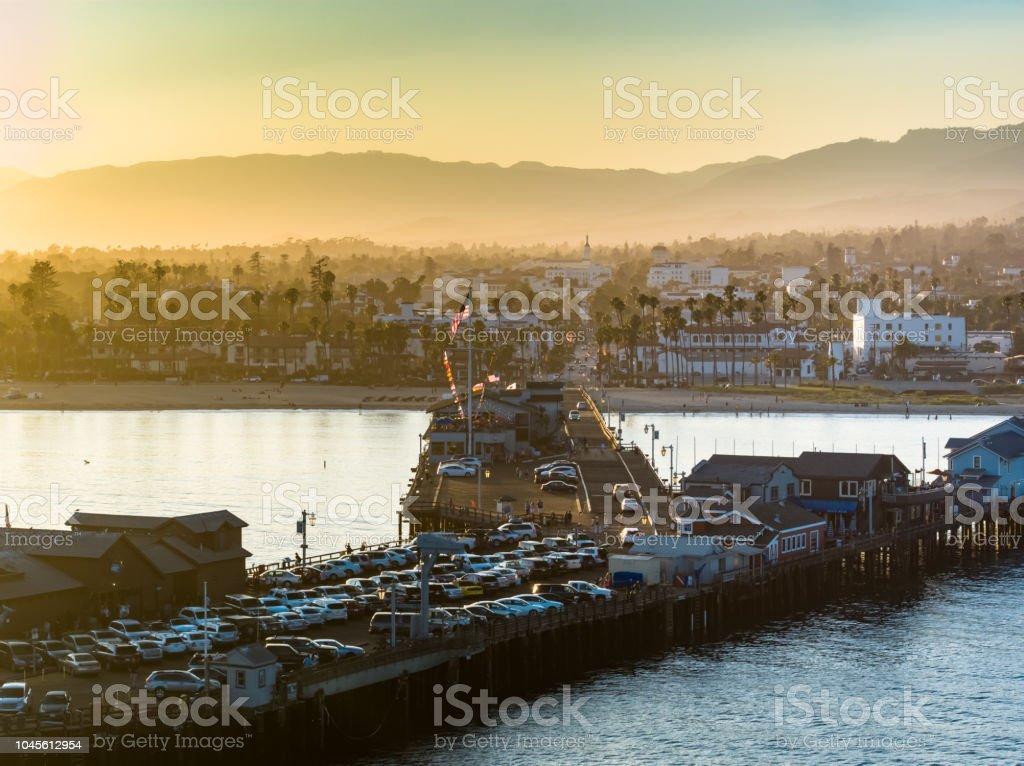 US Flag Flying Over the Santa Barbara Pier at Sunset - Aerial Shot stock photo