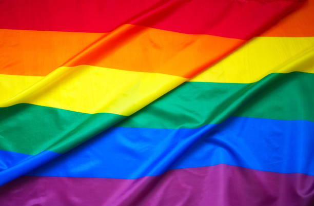 flag gay background flag gay background lgbtqi rights stock pictures, royalty-free photos & images