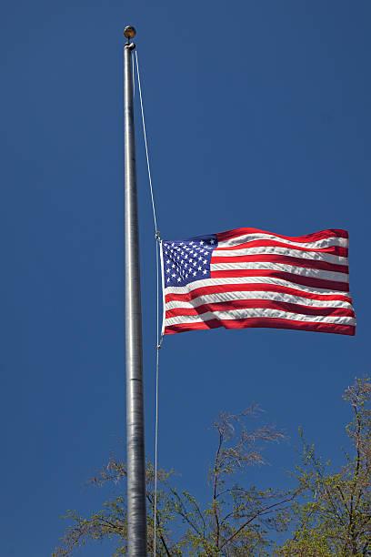 US Flag - Half mast stock photo
