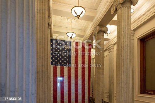 A US flag hanging at the corridor ceiling of US Capitol corridor ceiling, Interior, Washington DC.