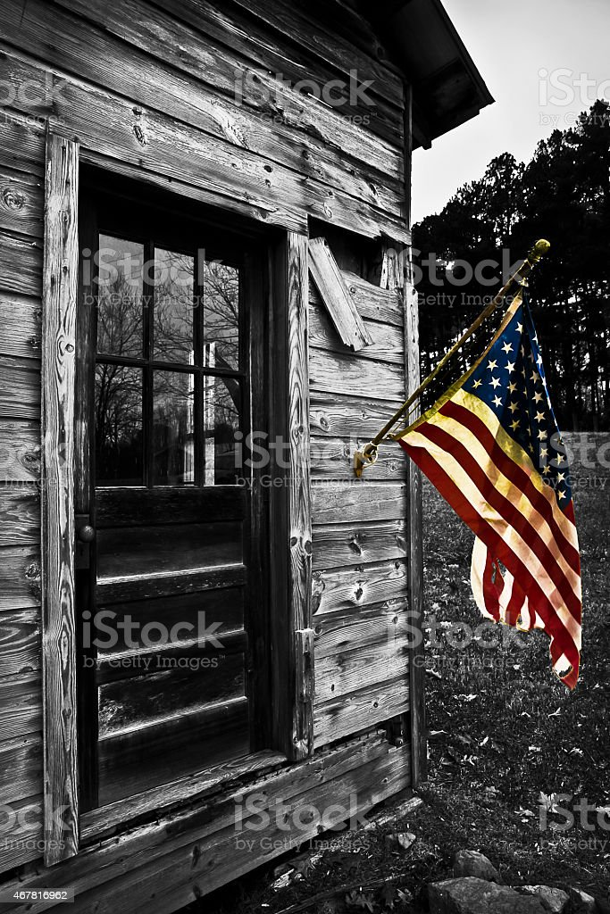 USA Flag Hangs From an Old Cabin Color Splash stock photo