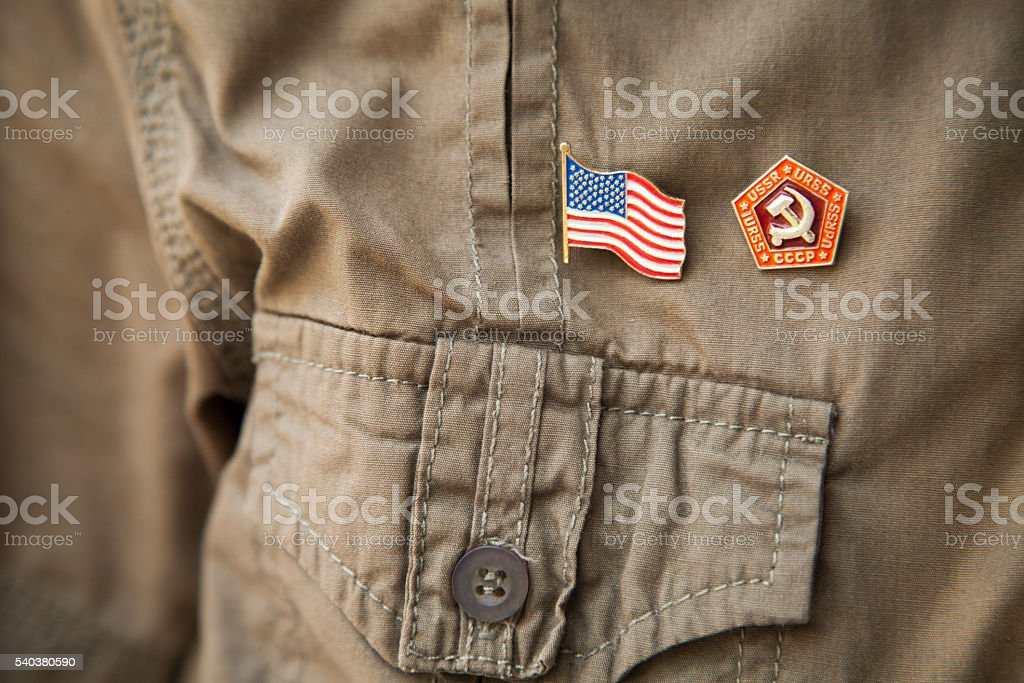 USSR & USA flag, historic national emblem on khaki shirt stock photo