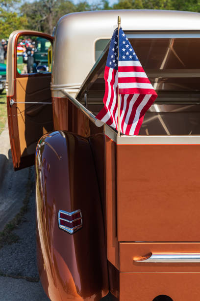 US flag in a vintage pickup truck. stock photo