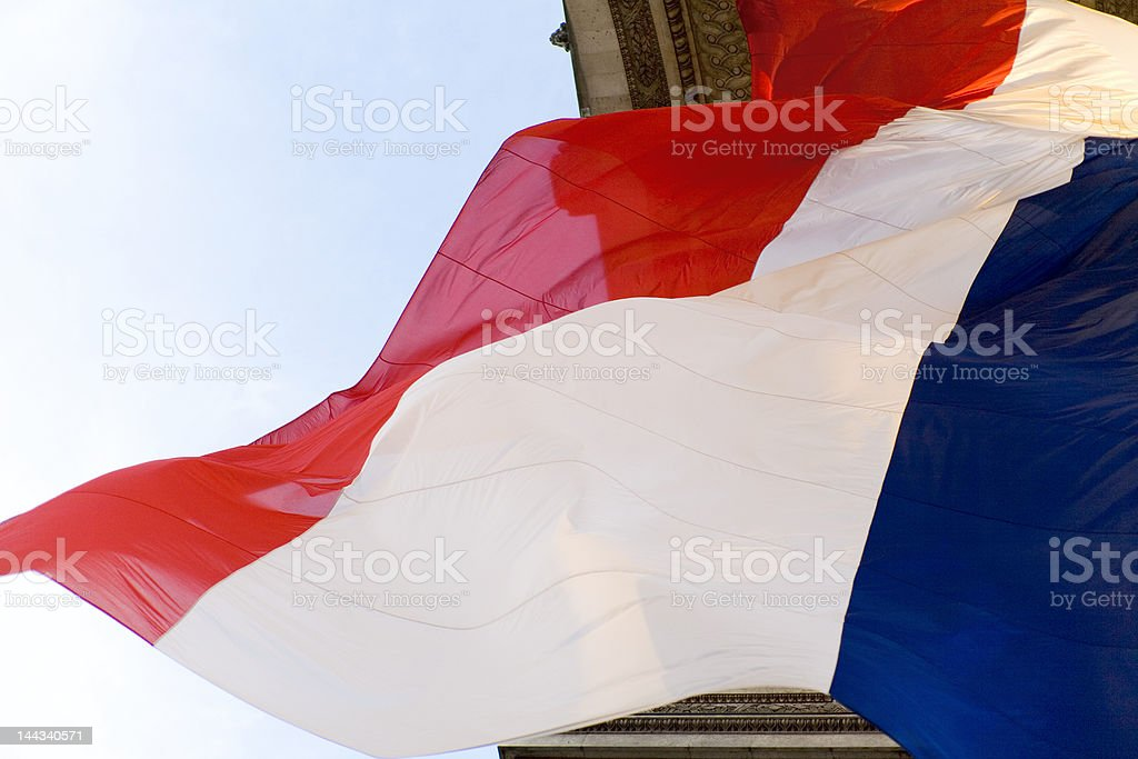 Flag in Arc De Triomphe stock photo