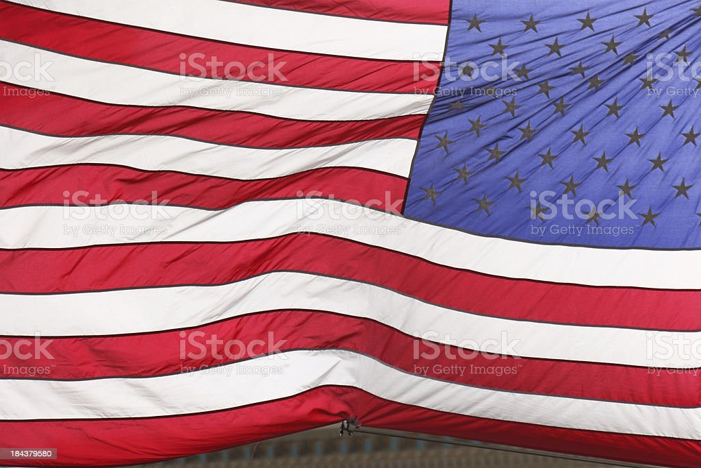 USA flag in front of a bank building royalty-free stock photo