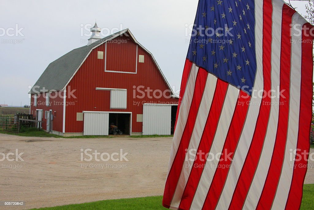 Flag in front of an Iowa Barn stock photo