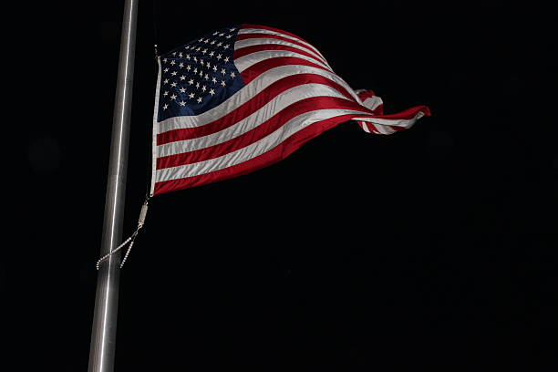 US Flag in the Wind at Night stock photo
