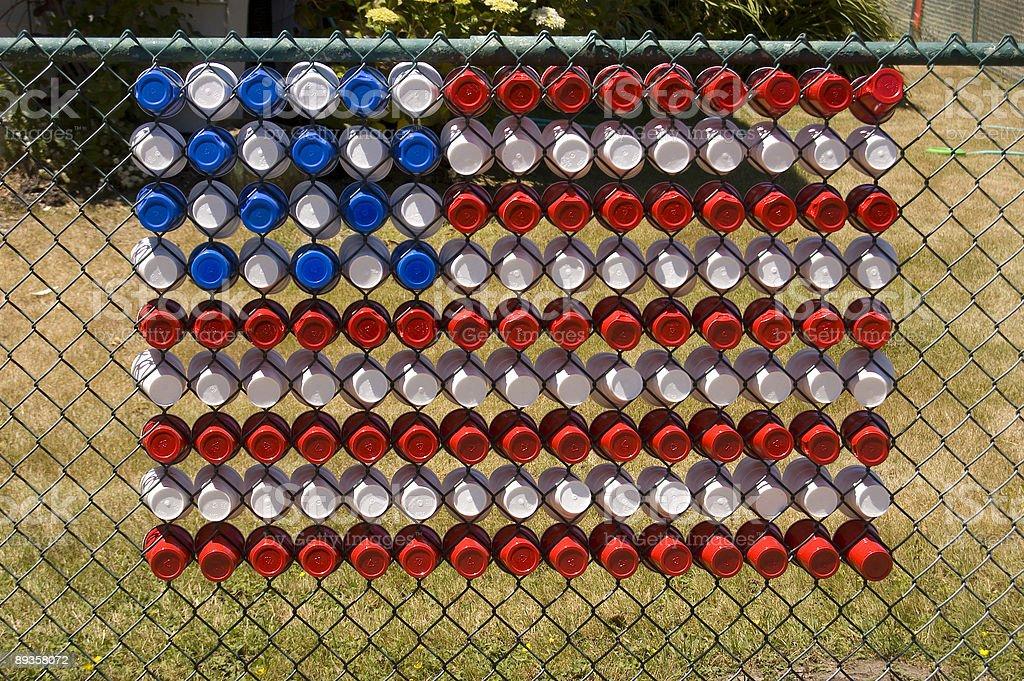 Bandiera USA in tazze in una parete foto stock royalty-free
