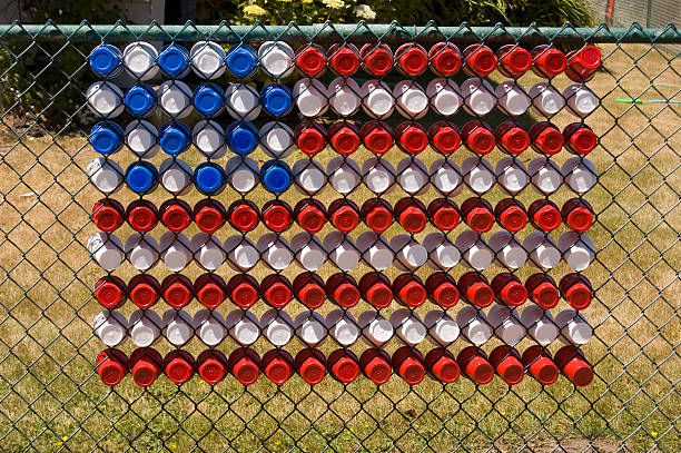 US flag made of cups in a fence stock photo
