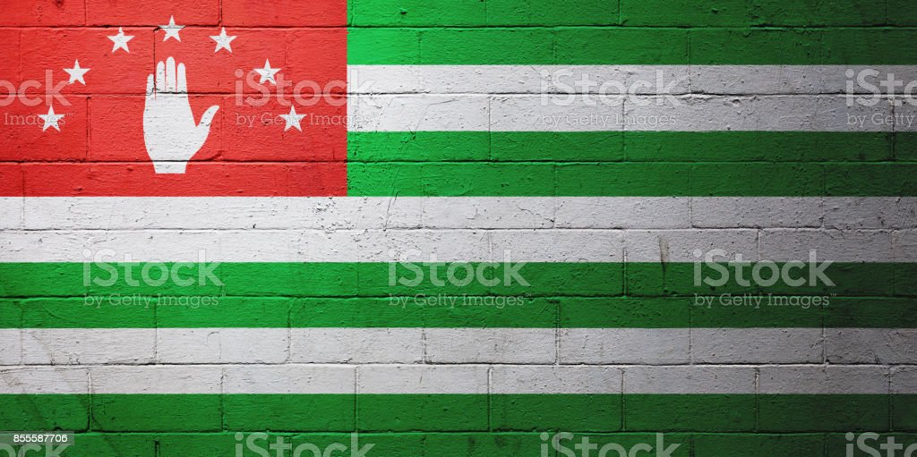 Flag of Abkhazia painted on a wall stock photo