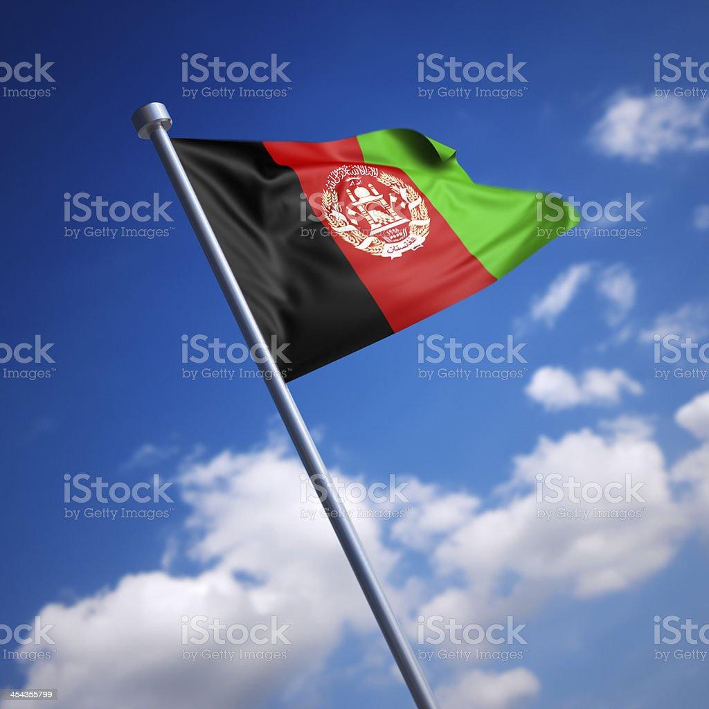 Flag of Afghanistan against blue sky stock photo