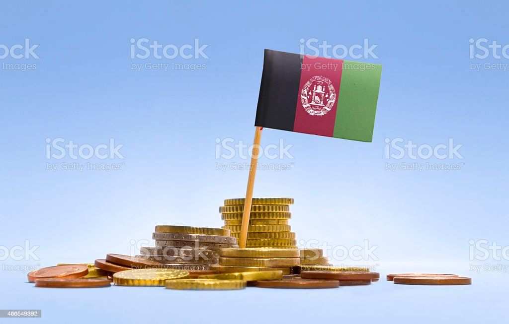 Flag of Afghanistan in a stack of coins.(series) stock photo