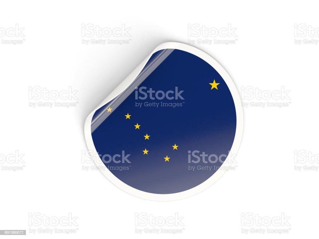 Bandeira do Alasca, nos estado redondo da etiqueta - foto de acervo