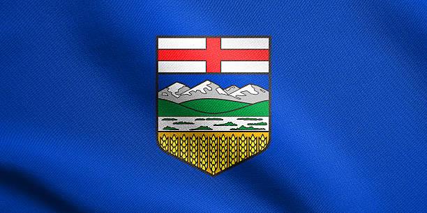 Flag of Alberta waving with fabric texture stock photo